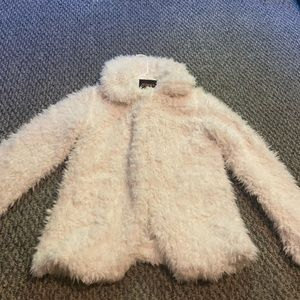 Cute ivory fuzzy jacket.
